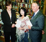 Receiving Cuirt Award Galway, 2005, from John Coyle and daughter, Zoe